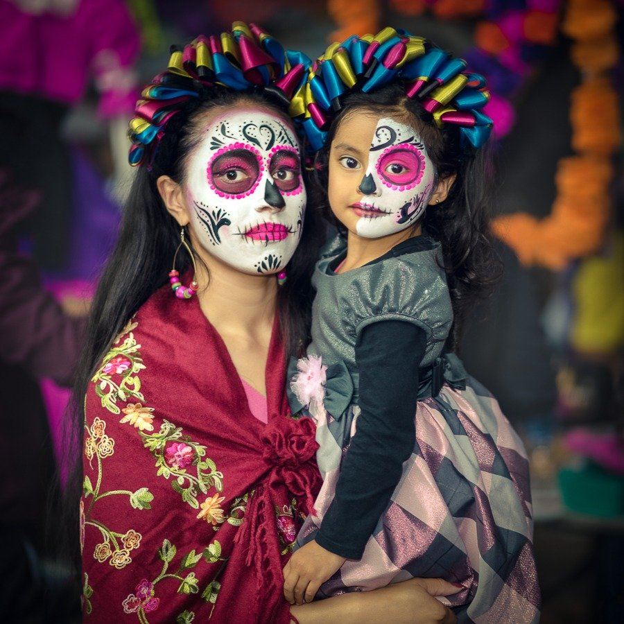 Mother and daughter at Day of the Dead